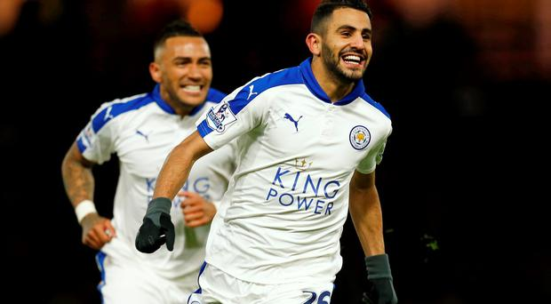 Riyad Mahrez celebrates after scoring the Leicester goal. Photo: Eddie Keogh/Reuters
