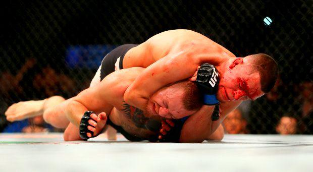 Nate Diaz applies a choke hold to win by submission against Conor McGregor during UFC 196 at the MGM Grand Garden Arena. (Photo by Rey Del Rio/Getty Images)