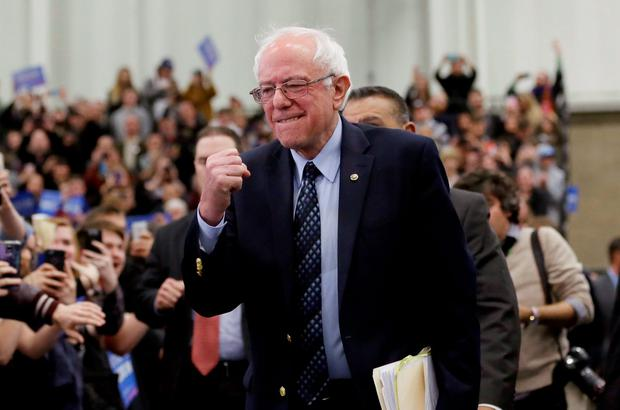 Democratic presidential candidate Bernie Sanders pumps his fist as he arrives for at a rally at the Macomb Community College Credit: Carlos Osorio (AP)