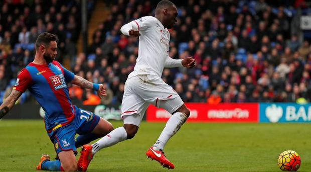 Crystal Palace's Damien Delaney fouls Liverpool's Christian Benteke resulting in a penalty