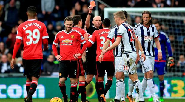 Match referee Mike Dean sends Juan Mata off during the Premier League match at The Hawthorns