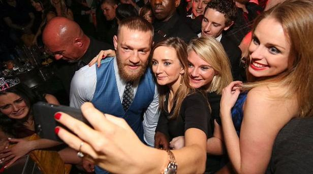 Conor McGregor poses with fans at Surrender nightclub, Las Vegas, following his defeat at UFC 196 to Nate Diaz. Picture credit: Twitter/@DanStupp