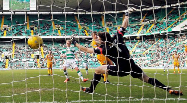 Celtic's Gary Mackay-Steven scores his sides second goal during the William Hill Scottish Cup, Quarter Final match at Celtic Park