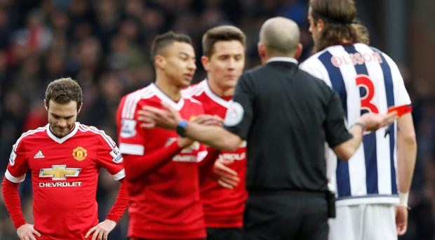 Manchester United's Juan Mata is sent off by referee Mike Dean