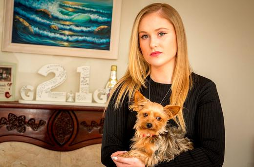 Aisling Golden holds Mylah. The dog belonged to her sister Gráinne, who died of cystic fibrosis. Her home in Sligo has become a shrine to Gráinne's memory. Photo: James Connolly