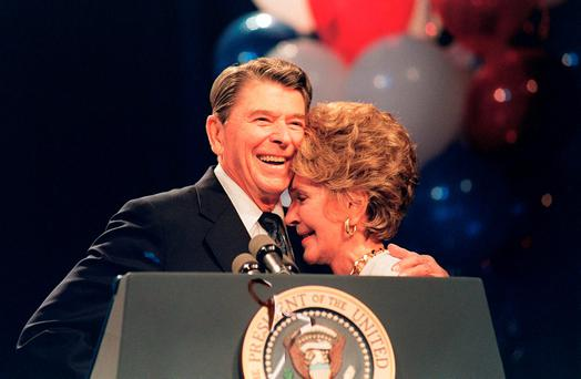 Nancy and Ronald share a moment of closeness in 1988. Photo: Getty