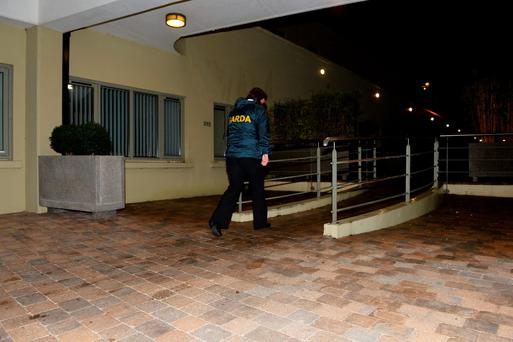 A garda stands outside the apartment in Killarney, Co Kerry. Photo: Domnick Walsh