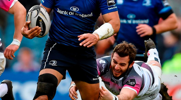 Ben Te'o, Leinster, is tackled by Tom Grabham, Ospreys Photo: Ramsey Cardy / SPORTSFILE