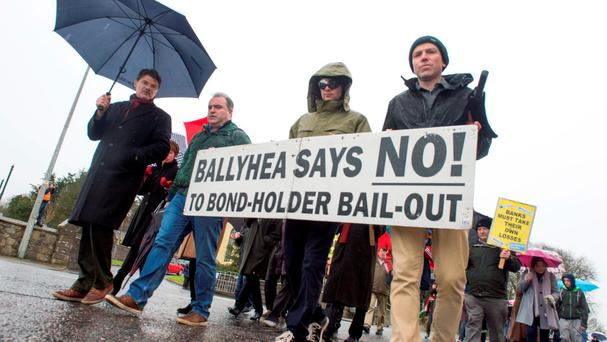 The final Ballyhea march against the bank bailout – led by Diarmuid O'Flynn (far left) – in Cork yesterday. Photo: Michael Mac Sweeney
