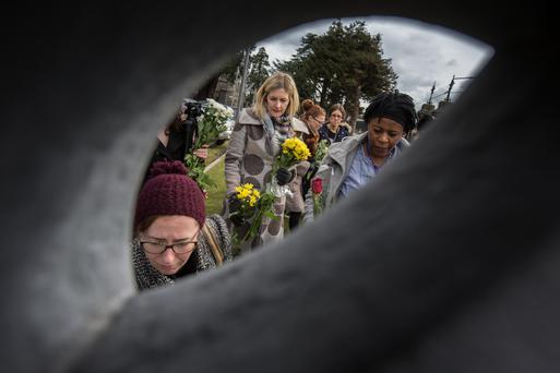 Flowers are laid to remember the women and girls who were incarcerated in Magdalene Laundries at Glasnevin Cemetery. Photo: Mark Condren