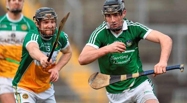 Diarmaid Byrne, Limerick, in action against James Mulrooney, Offaly Photo: David Maher / SPORTSFILE