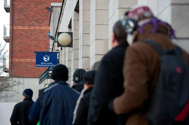 Recipients queuing outside a Social Welfare office Photo: Daragh Mc Sweeney/Provision