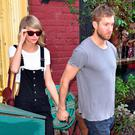 Taylor Swift and Calvin Harris leave the Spotted Pig restaurant on May 28, 2015 in New York City. (Photo by James Devaney/GC Images)