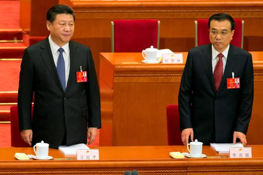 Chinese President Xi Jinping (L) and Chinese Premier Li Keqiang at the annual National People's Congress in Beijing's Great Hall of the People Credit: Ng Han Guan (AP)