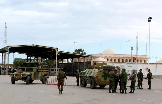 Tunisian soldiers standing guard at the border crossing at Ras Jdir Ben Guerdane, in this picture taken December 5, 2014. Reuters/Stringer/Files