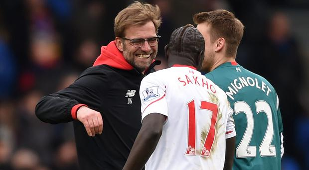 Liverpool manager Jurgen Klopp celebrates with Mamadou Sakho at the end of the match
