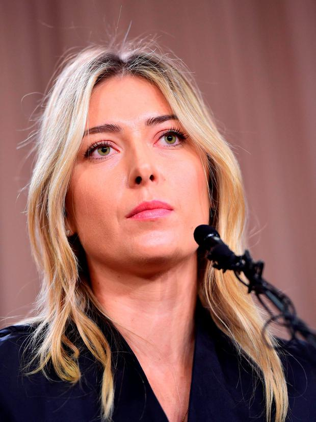 Russian tennis player Maria Sharapova speaks at a press conference in downtown Los Angeles, California, March 7, 2016. / AFP / Robyn BeckROBYN BECK/AFP/Getty Images