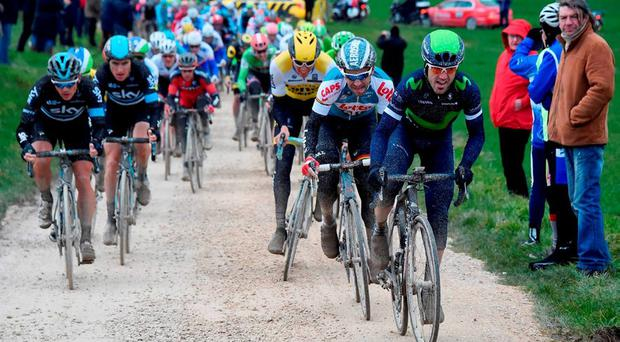 The peloton rides through one of the dirt road sections during the first stage of the 74th edition of the Paris-Nice cycling race between Conde-sur-Vesgre and Vendome on March 7, 2016. Photo: Bernard Papon/AFP /Getty Images