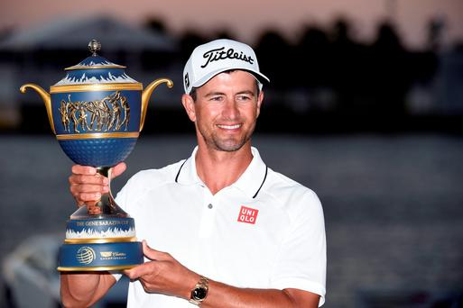Adam Scott celebrates with the WGC-Cadillac Championship trophy the Gene Sarazen Cup at Trump National, in Doral, Florida. Photo: John David Mercer/USA Today