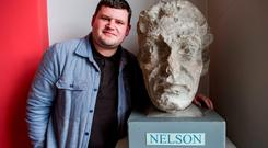 Historian Donal Fallon with the head of Nelson's statue, which now sits in Dublin City Council's Pearse Street Library. Photo: Douglas O'Connor