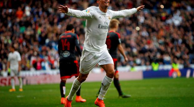 Real Madrid's Cristiano Ronaldo celebrates his fourth goal against Celta Vigo on Saturday: Photo: Susana Vera/Reuters
