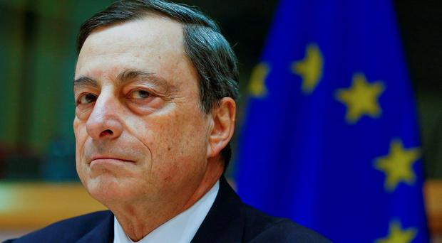 European Central Bank President Mario Draghi will expand asset purchases on Thursday, according to a Reuters poll of traders. Photo: Yves Herman/Reuters