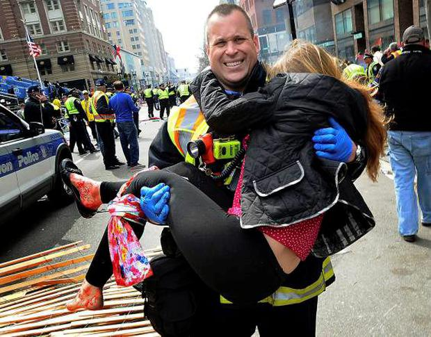 Boston firefighter James Plourde carries Victoria McGrath from the scene of the bombing in April 2013