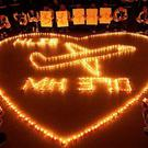 International school students light candles to pray for passengers aboard Malaysia Airlines flight MH370, in Zhuji, China