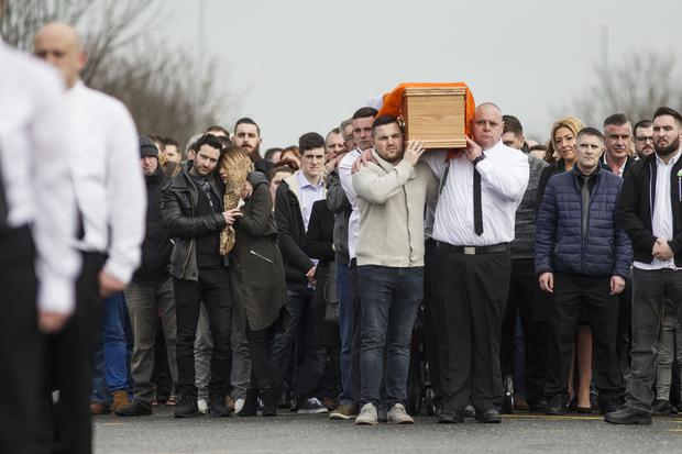 The remains of Vinnie Ryan are brought to his funeral mass in Donaghmede