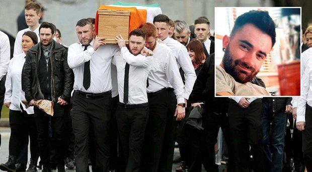 Mourners at the funeral carry Vinnie Ryan's coffin