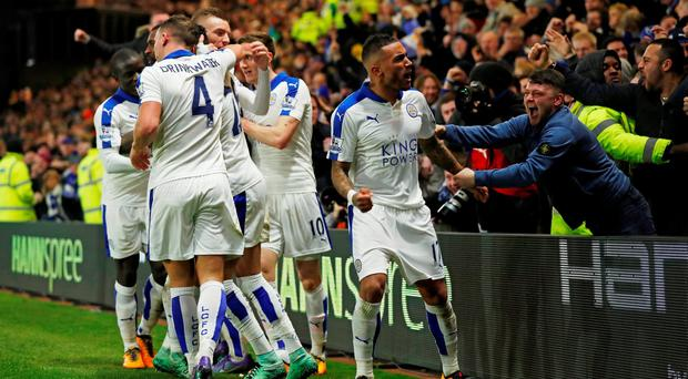 Riyad Mahrez celebrates with team mates and fans after scoring the winner for Leicester at Vicarage Road on Saturday. 'We're nine games away from the greatest underdog story in the history of sport'. Reuters / Eddie Keogh
