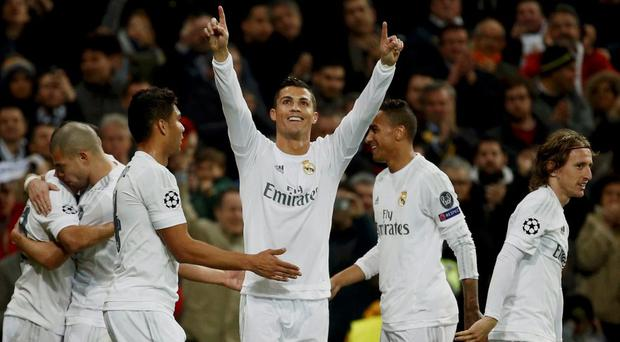 Real Madrid's Cristiano Ronaldo celebrates with team mates after scoring.