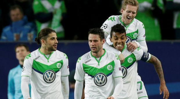 Wolfsburg's Andre Schuerrle celebrates with team mates after scoring