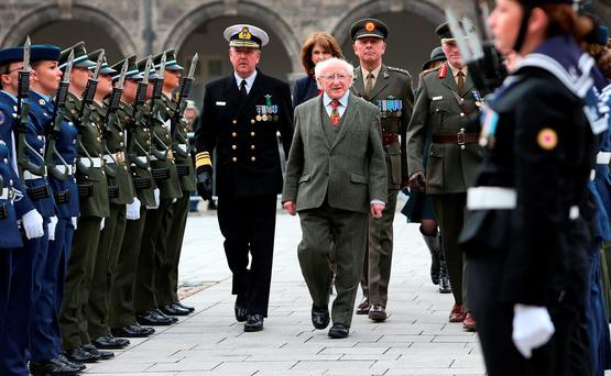 President Michael D. Higgins (centre) inspects an all female Captain's Guard of Honour, during the Commemoration for women in the 1916 Rising, as part of 1916 State commemorations, at the Royal Hospital Kilmainham, Dublin. Photo: Brian Lawless/PA Wire