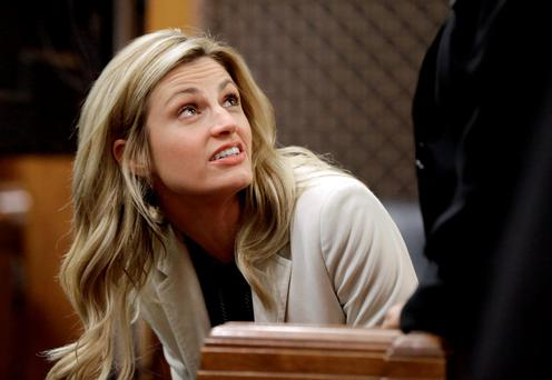 Sportscaster and television host Erin Andrews talks with an attorney in the courtroom Thursday, Feb. 25, 2016, in Nashville, Tenn