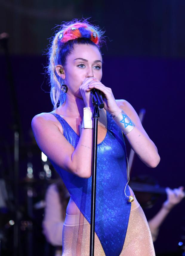 Miley Cyrus performs for James Franco's concert for Hilary Clinton.