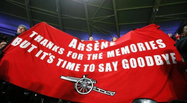 Arsenal fans protest at Arsene Wenger's reign during the win at Hull