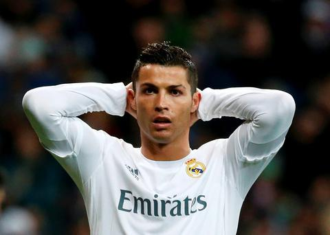 Real Madrid's Cristiano Ronaldo reacts to a miss last night