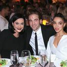 Actor Robert Pattinson (pictured with singers Katy Perry and FKA twigs) has revealed that he's working on his own clothing line. (Photo by Mark Davis/Getty Images)