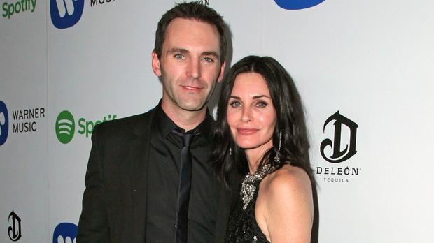 Johnny McDaid with Courtney Cox.