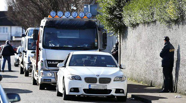 Gardai at the scene this morning with one of the luxury cars