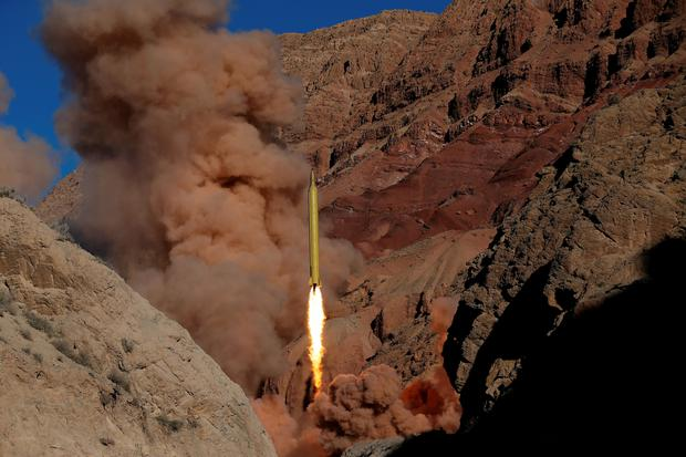 A photo obtained from the Iranian Fars News Agency of a Qadr H long-range ballistic surface-to-surface missile being fired by Iran's powerful Revolutionary Guard Credit: Fars News Agency (AP)