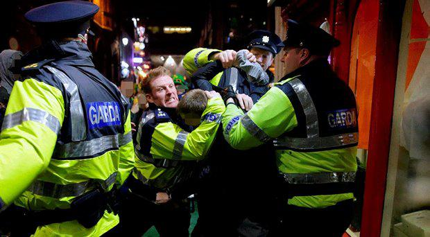 Gardai deal with a reveller causing a disturbance during the St Patrick's Festival in Temple bar last year