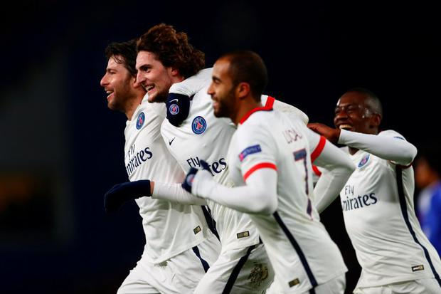 Adrien Rabiot is congratulated by teammates after scoring the opening goal