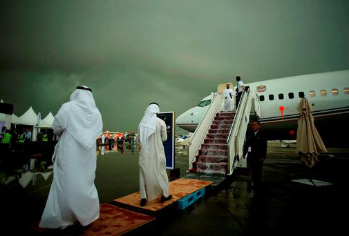 People stand at Al Bateen airport during a rainstorm in Abu Dhabi, UAE. Reuters/Stringer