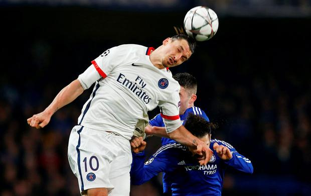 PSG's Zlatan Ibrahimovic tries to win the ball ahead of Chelsea's Gary Cahill and Cesc Fabregas Photo: Reuters / Eddie Keogh