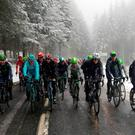 The pack rides under the snow during the third stage of the 74th edition of the Paris-Nice cycling race KENZO TRIBOUILLARD/ AFP/ Getty Images
