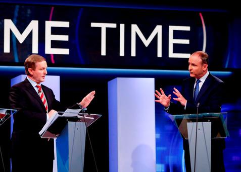 Enda Kenny (left) was warned by his party to 'tread carefully' in any talks with Fianna Fail's Micheal Martin (PA)