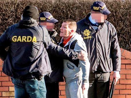 James Byrne, brother of Regency Hotel victim David, is pictured during a CAB raid on a propety in Raleigh Square in Crumlin, Dublin