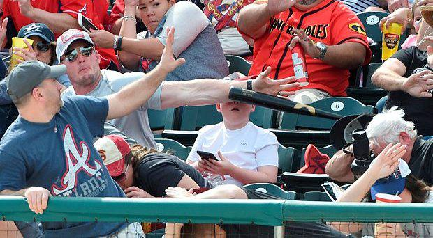 Shaun Cunningham saves his son Landon from a bat that rocketed out of a player's hands and into the stand Photo: Christopher Horner/Pittsburgh Tribune-Review